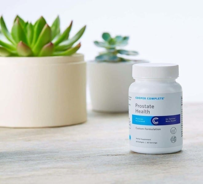 Cooper Complete Prostate Health Dietary Supplement with succulents behind