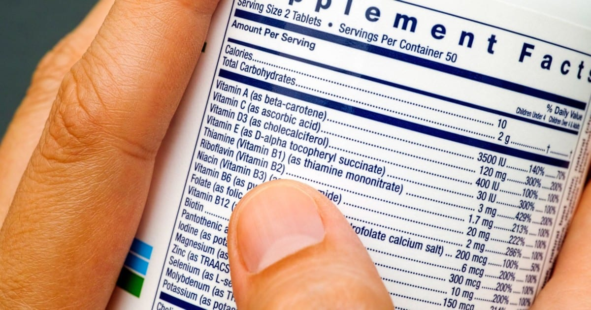 Vitamin Supplement label being looked at
