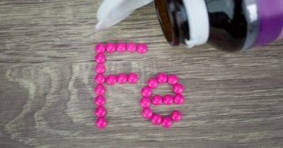 iron supplement tablets arranged to show elemental symbol of iron