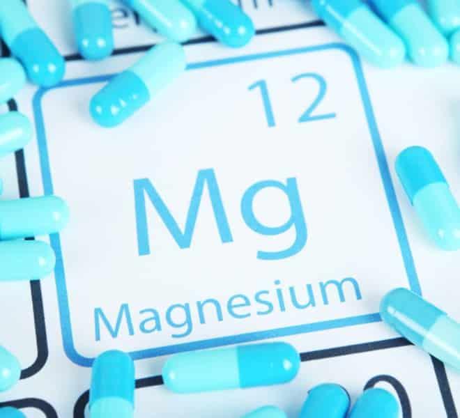 magnesium supplements around a magnesium paper