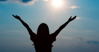 Woman celebrating because she raised her vitamin d levels