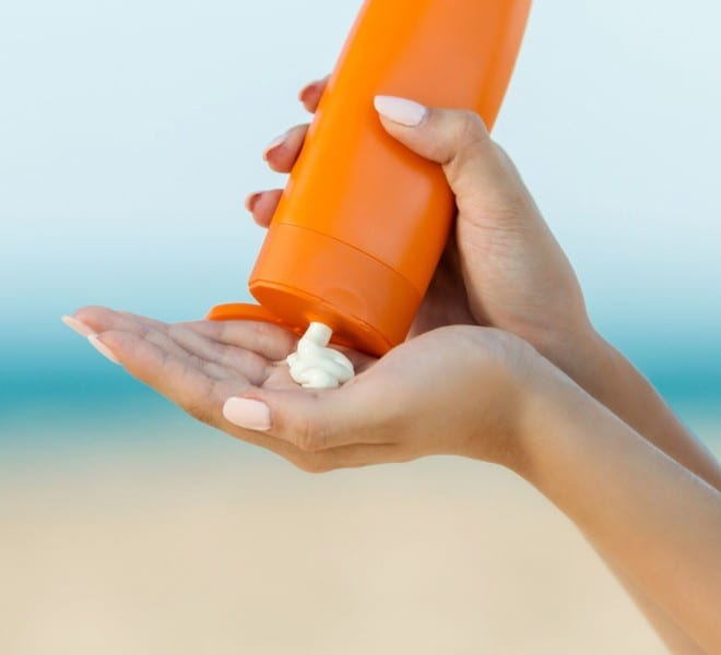 Sunscreen being applied at the beach