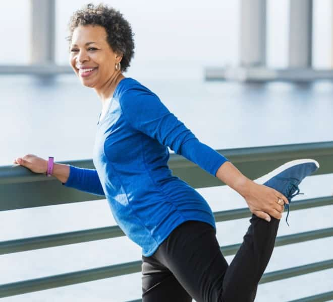 Woman Stretching to warm up for run