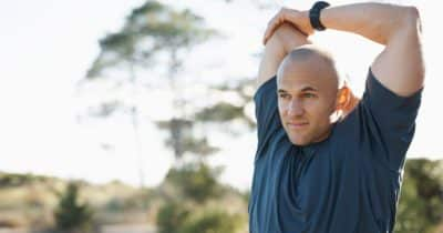 Active man stretching before exercise