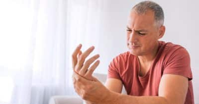 Arthritis symptoms bothering hand of a man