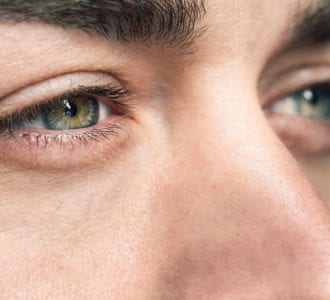 Man looking at supplements for eye health